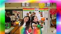 Two students show off their experiment.